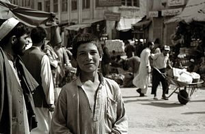Street children - An Afghan street boy photographed in downtown Kabul, Afghanistan (June 2003).
