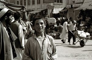 Afghan street urchin smiles for the camera in downtown Kabul, Afghanistan (June 2003).
