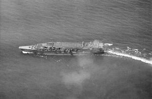 Japanese aircraft carrier Kaga - Kaga conducting air operations in 1930. On the upper deck are Mitsubishi B1M torpedo bombers preparing for takeoff. Nakajima A1N Type 3 fighters are parked on the lower deck forward.