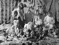Kayiagamute (Kauwerak) Wolf Dancers wearing regalia against backdrop of furs, vicinity of Nome, Alaska, between 1908 and 1915 (AL+CA 6428).jpg