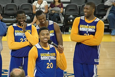 Kent Bazemore speaks at Warriors open practice with Green, Barnes, and Ezeli in background.jpg