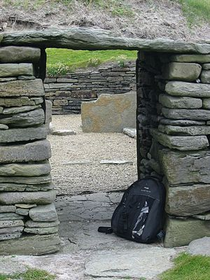 Knap of Howar - Looking back through the low entrance doorway into the main house, a visitor's backpack gives an idea of scale.