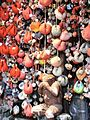 Kukurizaru talismans and monkey statue (Yasaka Koshindo Temple, Kyoto).jpg