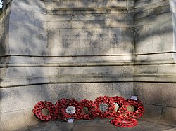 LNWR War Memorial, Euston - west elevation inscription and poppies.jpg