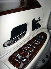 The redesigned door panels with new seat controls and additional wood trim