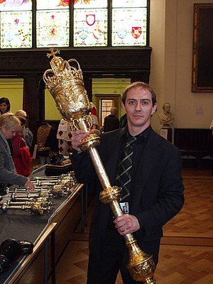 Ceremonial mace - A court official holds the mace of the Lord President of the Court of Session, Scotland, during a Doors Open Day. Also known as the Old Exchequer Mace, it was made in London in 1667, of silver gilded with 24 carat gold, and weighs around 8 kg (17 lb).
