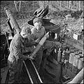 M7 Priest crew refilling shell rack 17-01-1944 IWM NA 10923.jpg