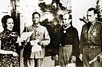 Madame Chiang Kai-shek presenting awards to BG Doolittle and COL Hilger, 1942 (24395377696).jpg
