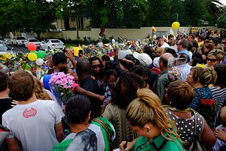 Death of Nelson Mandela - Members of the public paying their respects outside Mandela's Houghton home.