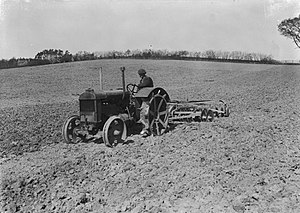 Harrow (tool) - Harrowing with tractor and disk harrow in the 1940s)