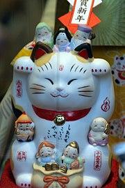 Maneki neko with 7 Lucky Gods by OiMax in Asakusa, Tokyo.jpg