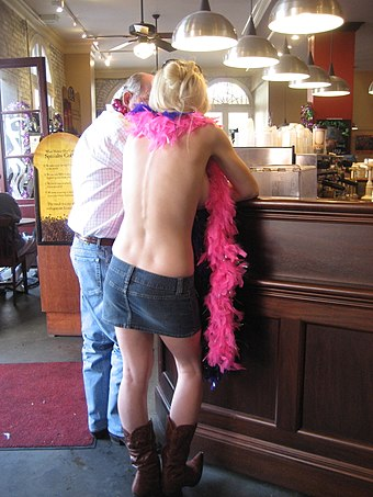 A topless woman at a coffee house, Mardi Gras event in New Orleans, 2009 MardiGras2009CoffeeCustomers.JPG