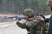 A U.S. Marine fires the AK-47.