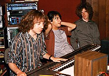 Mitch Easter sitting at a mixing board next to two musicians