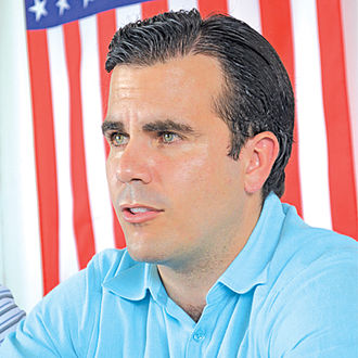 Ricardo Rosselló, in a light-blue polo shirt