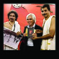 Mr Nick Ut with Anil Gurukkal and Sunil Gurukkal at CVN Kalari Nadakav Calicut.jpg