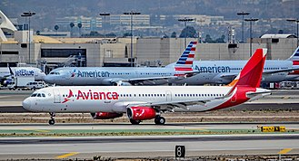 Los Angeles International Airport - An Avianca Airbus A321 with numerous American Airlines aircraft in the background