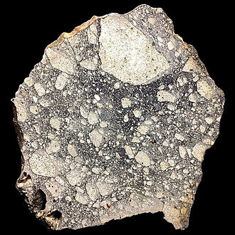 Lunar meteorite - Large slice of NWA5000, the largest known lunar meteorite. It was found in the Sahara desert in 2007.
