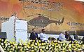Narendra Modi addressing at the foundation stone laying ceremony for HAL Helicopter Factory, at Tumakuru, Karnataka. The Governor of Karnataka, Shri Vajubhai Rudabhai Vala, the Union Minister for Defence (1).jpg