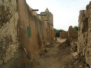 Podor Department - Village street and mosque in Podor