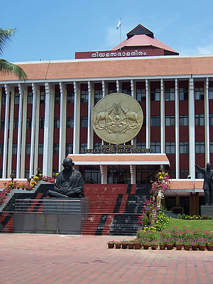 Kerala Legislative Assembly - The entrance to Kerala Legislature with statute of Mahatma Gandhi