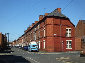 The Meadows, Nottingham - Three storey terraced housing on Wilford Crescent East showing common roof profile