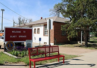 Olney Springs, Colorado - Olney Springs' town hall and welcome sign.