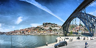 Dom Luís I Bridge - A oblique perspective of the bridge showing the historic centre of Porto and main archway