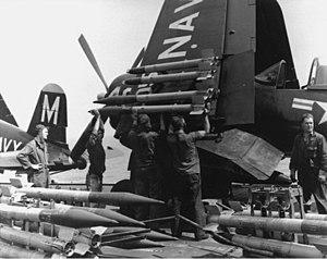 Ordnancemen load rockets on a Vought F4U-4B of VF-64 aboard USS Philippine Sea (CV-47) on 21 May 1951 (80-G-439903).jpg