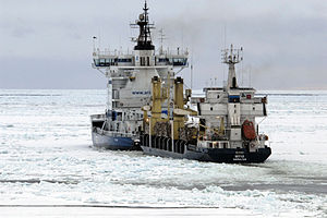Otso (icebreaker) - Otso escorting a merchant ship in the Gulf of Bothnia in March 2011. Close towing, in which the escorted ship is pulled to the towing notch of the icebreaker, is commonly used for smaller vessels.