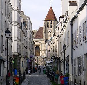 Charonne quarter - Rue Saint-Blaise and the church of Saint-Germain-de-Charonne in the background