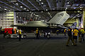 Personnel move a U.S. Navy X-47B Unmanned Combat Air System demonstrator aircraft in the hangar bay of the aircraft carrier USS George H.W. Bush (CVN 77) May 14, 2013, in the Atlantic Ocean 130514-N-TB177-025.jpg