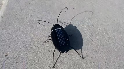 File:Photovoltaic bug mini robot.webm
