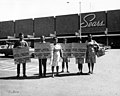 Picketers from ILGWU Local 148-102 holding placards in English and Spanish that announce their strike against Sears Roebuck for unfair labor practices, February 1965. (5279091367).jpg
