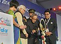 Pranab Mukherjee lighting the lamp to inaugurate the FDI Annual World Dental Congress, hosted by the Indian Dental Association, at Noida, Uttar Pradesh. The Governor of Uttar Pradesh, Shri Ram Naik is also seen.jpg