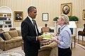 President Barack Obama presents a birthday cake to Personal Secretary Anita Decker in the Oval Office.jpg