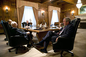 First Presidency - George W. Bush (right) meets with the LDS Church First Presidency in August 2006 in the Church Administration Building. Seated clockwise are: Gordon B. Hinckley, President; Thomas S. Monson, First Counselor (obscured); James E. Faust, Second Counselor (obscured); and F. Michael Watson, then Secretary to the First Presidency. Since this picture was taken, Hinckley and Faust have died and the First Presidency has been reorganized.