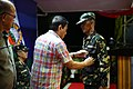 President Rodrigo Duterte awards a medal to a soldier during the 10th anniversary celebration of the Eastern Mindanao Command.jpg