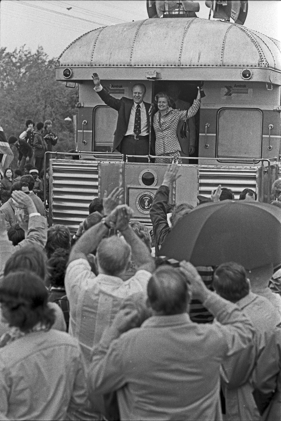 President and Mrs. Ford wave during their primary campaign in Michigan - NARA - 7027911