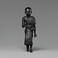 Priest in a leopard skin cloak with an inscription and Osiris on his skirt MET DP139126.jpg