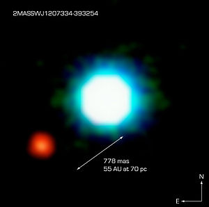 Discoveries of exoplanets - Infrared image of 2M1207 (bluish) and 2M1207b (reddish). The two objects are separated by less than one arc second in Earth's sky. Image taken using the European Southern Observatory's 8.2 m Yepun Very Large Telescope