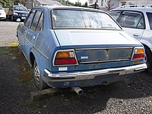 The Rear View Of A Publica Starlet Sedan.