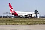 Qantas (VH-OGN) Boeing 767-338ER taking off on runway 25 at Sydney Airport.jpg