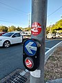 Queensland Government COVID-19 preventative measures stickers on a pedestrian signal pole.jpg