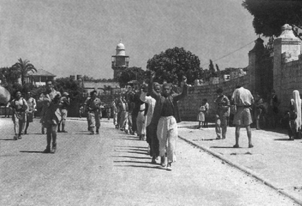 Arab forces surrender to the victorious Israelis in Ramla. Ramla prisoners of war, July 12-13, 1948.png