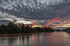 Red and grey clouds over the Mekong at sunrise in Don Det Laos.jpg