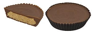 English: Reese's Peanut Butter Cups, one with ...