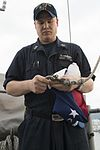 Retiring U.S. Navy Captain's flag is flown aboard USS Bonhomme Richard 170112-N-XT039-037.jpg