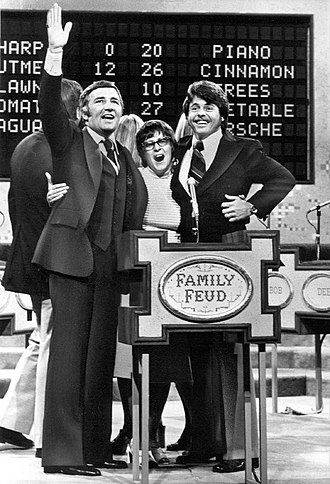 Richard Dawson - Richard Dawson (host) and contestants on the pilot episode of Family Feud.