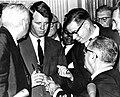 Robert Kennedy, Roy Reuther, and President Johnson at signing ceremony of the Civil Rights Act of 1964.jpg